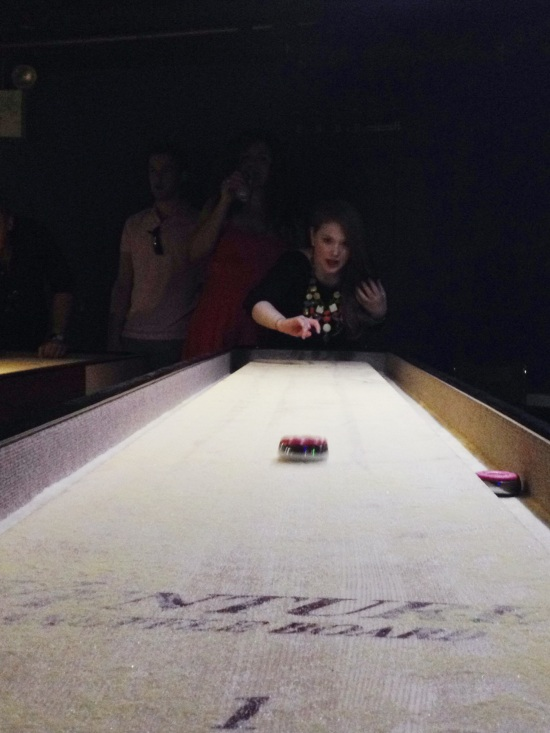 Evey playing shuffleboard
